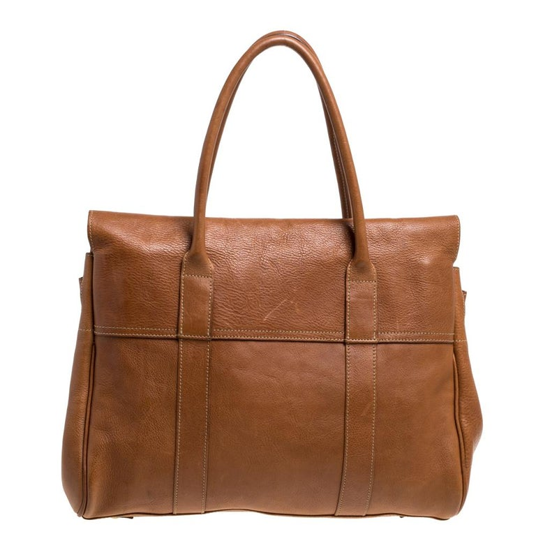 The Bayswater is one of the most well-known collections from Mulberry, so it's fair to say that this satchel is worth the buy. Crafted from leather, the bag is equipped with two handles and a turn lock on the flap securing a capacious compartment