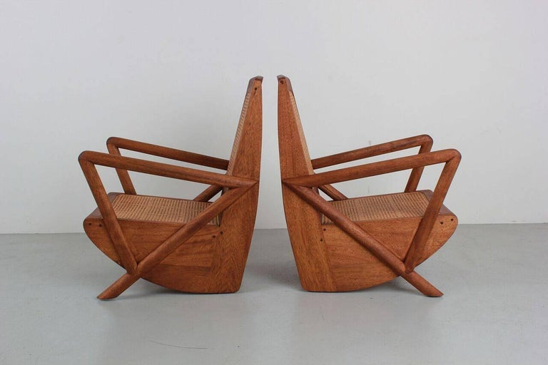 Gorgeous pair of teak and caned chairs based on a French design. Newly produced with wonderful lines. Caned seat and back.