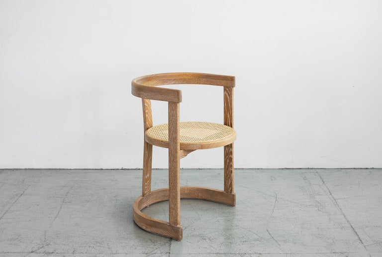 Wonderfully curved bentwood oak dining chairs with caned seat. Newly produced by Orange collection. Cerused oak finish.
