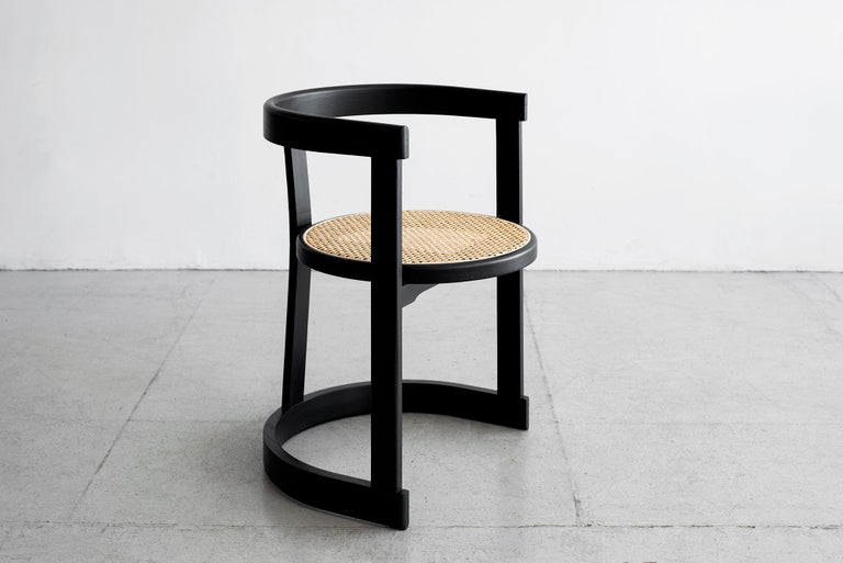 Wonderfully curved bentwood French oak dining room chairs with caned seat. Newly produced by Orange Furniture collection. Shown in ebony finish, also available in cerused oak.