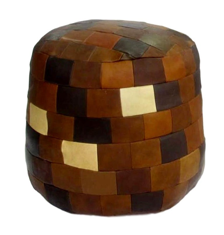 Unique patchwork leather ottoman by De Sede with multi-colored leather strips. Cylinder shape. various brown, tan and green leather colors. Great coloring and patina to leather. Very good condition. Great accent piece.  6-7 ottomans and beanbags