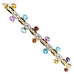Multi-Color Oval Shaped Gemstones White Zircon 18 Karat Gold Bracelet