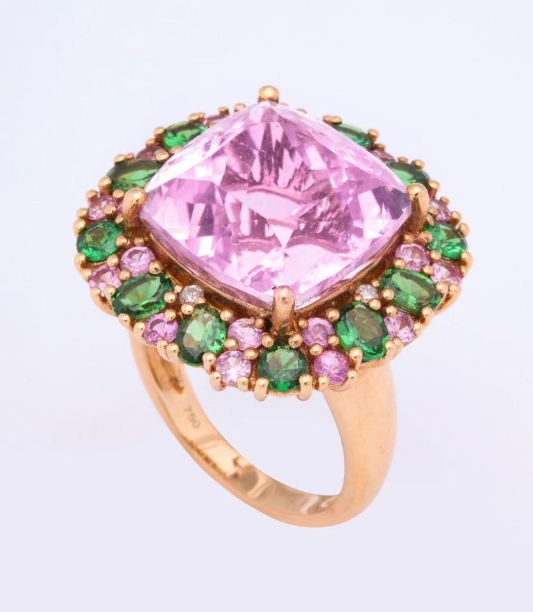 18kt yellow gold multi color ring featuring a central cushion cut kunzite, surrounded by smaller kunzites, tsavorite garnets and diamonds. Size 6 but can be sized on request.