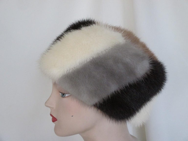 This mink fur hat is made in 4 different colors of soft and supple mink. Its in pre-owned vintage condition. Circumference about 57 / 58 cm -  22.44/ 22.83 inch Please note that vintage items are not new and therefore might have minor imperfections.