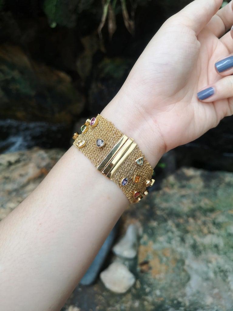 Rainbow Colour Sapphire 16.75 carats Bracelet set in 18 Karat Gold Settings  Width:  2.8 cm  Length: 18.5 cm Total Weight: 56.37 grams