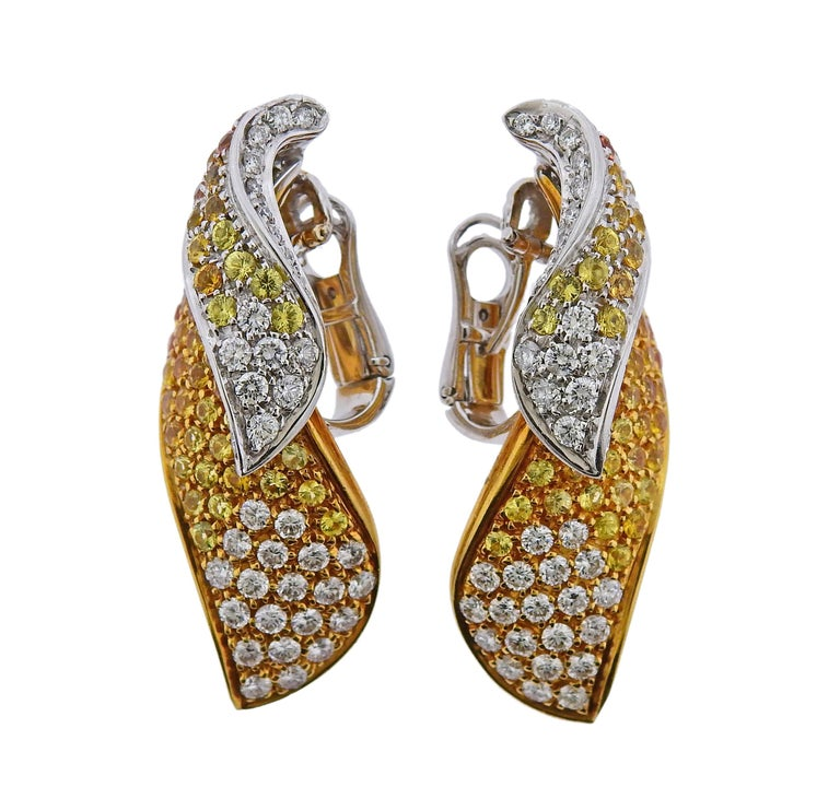 Pair of 18k white and yellow gold earrings, adorned with approx. 5.90ctw in yellow and orange sapphires, and 3.00ctw in G/VS diamonds. Earrings are 41mm x 18mm, with collapsible posts. Weight is 31.5 grams. Marked Dal Lago 750.
