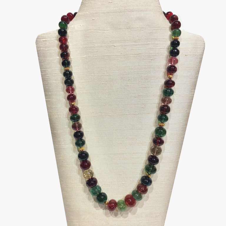 25 in (64cm) gradualed necklace with multi-colour tourmaline and 18K gold beads.  An important necklace with exquisite quality tourmaline gradualed beads. A stunning example of its kind.