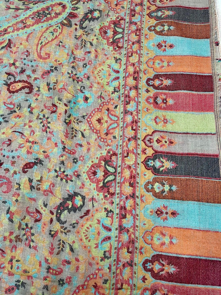 A magnificient traditional Kani pattern pashmina shawl alluring colors highlighting Paisleys and lotus pattern. It can be considered as traditional kashmiri design pattern.  very warm but  very soft. Best to keep in your purse for movie theater,