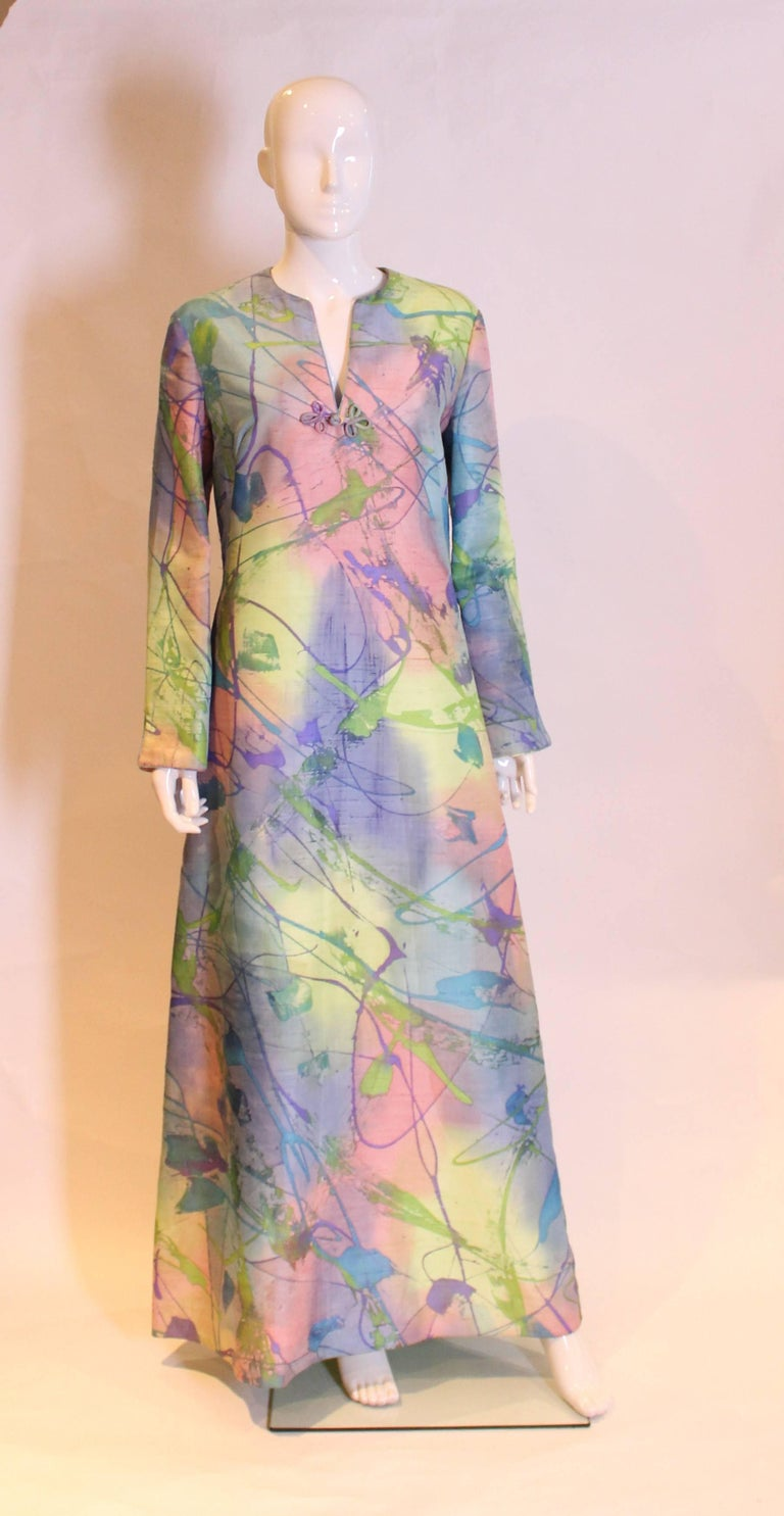 A great dress for Summer, in a multitude of colours. This silk kaftan dress is fully lined and hangs beautifuly , and has a pocket on either side.