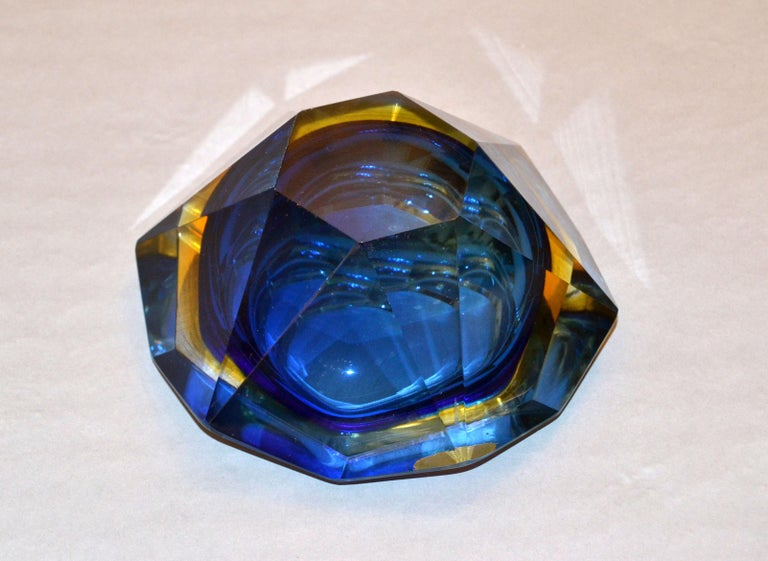 Multifaceted blue, yellow and clear Murano glass ashtray, glass bowl attributed to Flavio Poli by V.A.M. Vetri Molati Murano, Italy.