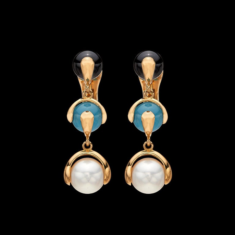 Playful and bold earrings by famed Italian designer Marina B. of the one and only Bulgari family. The 18k gold drop earrings are designed with 9.5mm cultured pearls, together with blue chalcedony and black spinel beads, and will brighten any outfit.