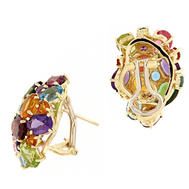 """Truly a stunning display of color! These """"party"""" earrings feature a multi-color cluster of amethyst, citrine, peridot, garnet, and topaz set in 18k yellow gold. These post earrings feature omega backs Weigh 18.2 grams."""