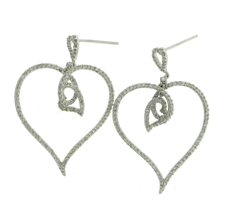 Brilliance Jewels, Miami Questions? Call Us Anytime! 786,482,8100  Style: Heart Dangle Earrings  Metal: White Gold  Stones: 154 Round Diamonds (127 Each Earring)  Diamond Color: G-H  Diamond Clarity: VS  Total Carat Weight: Approx. 1.54 ct   Total