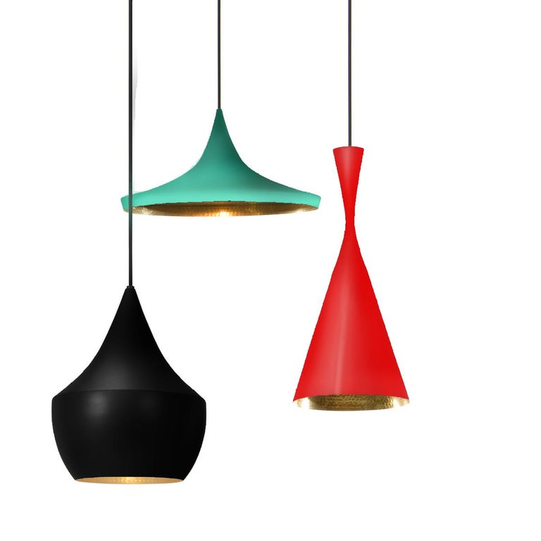 Each light is a bold statement in its own right but our carefully curated and customized multi-color chandelier is truly one-of-a-kind. Enameled brass, hammered on the inside, hang from circular ceiling canopy, creating endless reflections, spatial