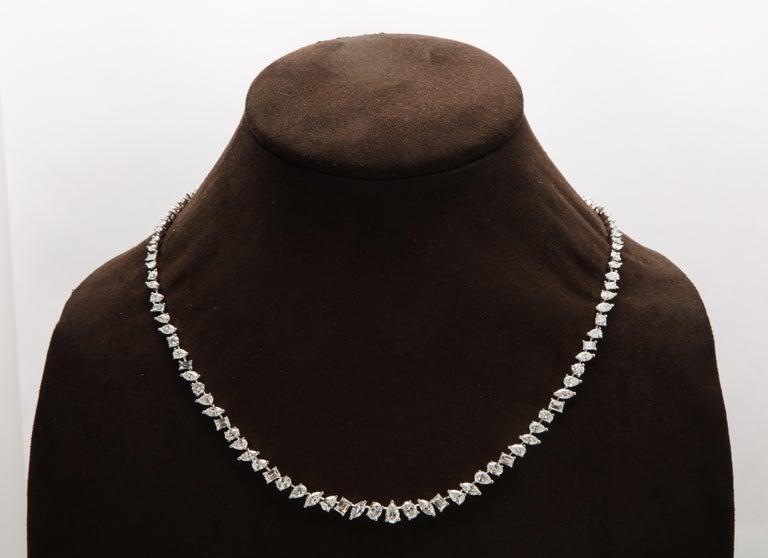 A unique diamond necklace.  17.20 carats of oval, pear, emerald, marquise and round cut white diamonds set in 18k white gold.   16 inch length with a removable piece to wear at 15 inches.   This necklace can be dressed up or down, perfect for a