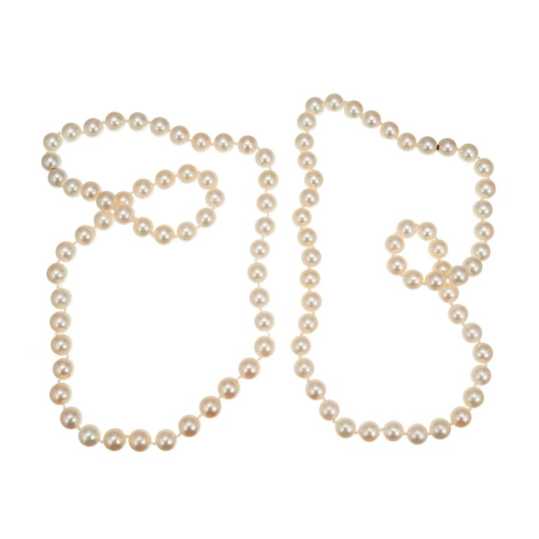 Cultured pearl necklace set with 7.5 to 8mm pearls. 17 Inch and 19 Inch necklaces, both with mystery clasps that allow them to be worn separately, together as a two-strand necklace or joined.  51 cultured white with pink overtones 7.5-8mm pearls 53