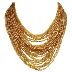 Multi Strand Gold Glass Bead Necklace with Beaded Clasp, circa 1960s