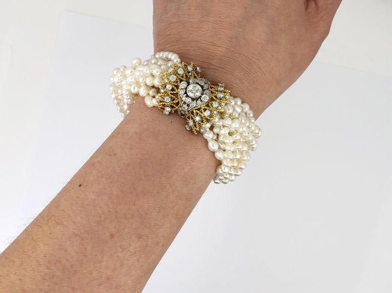 Two Tone Gold Diamond and all natural pearl Bracelet. Circa 1970s. Measures approx. 6.75