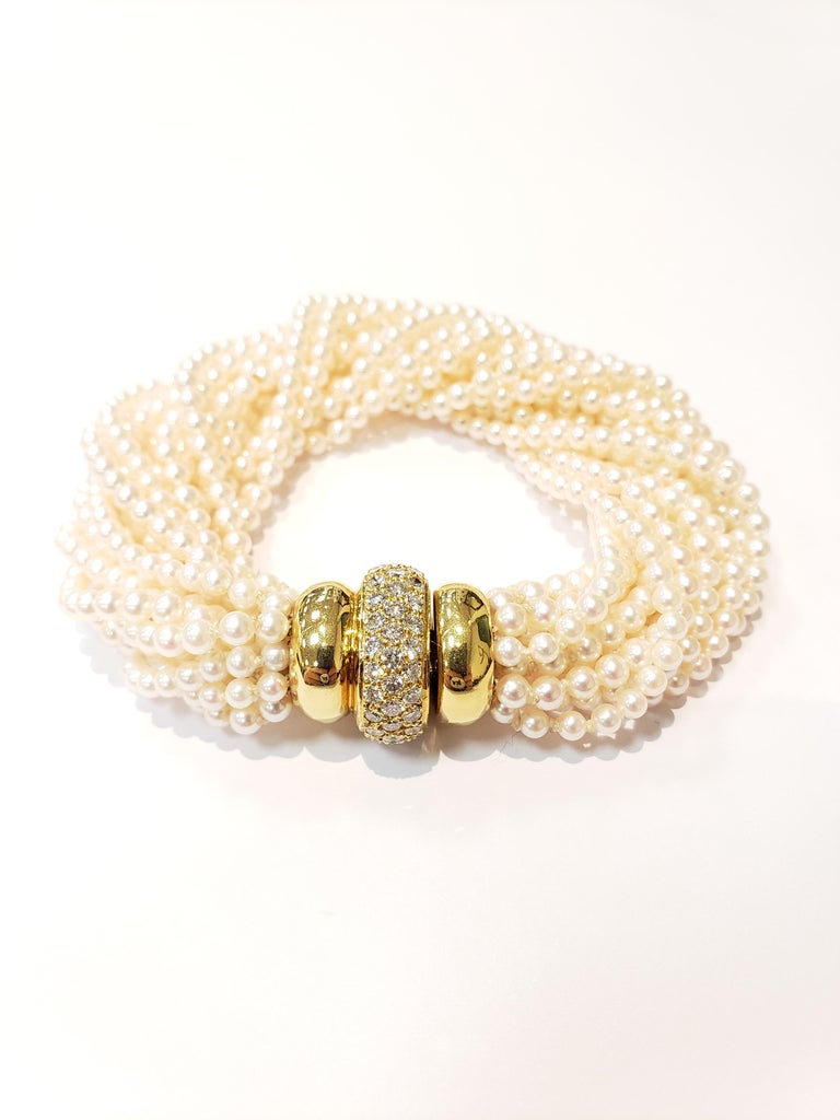 Contemporary Multi Strand Seed Pearl Bracelet with 18 Karat Gold and Pave Diamond Clasp For Sale