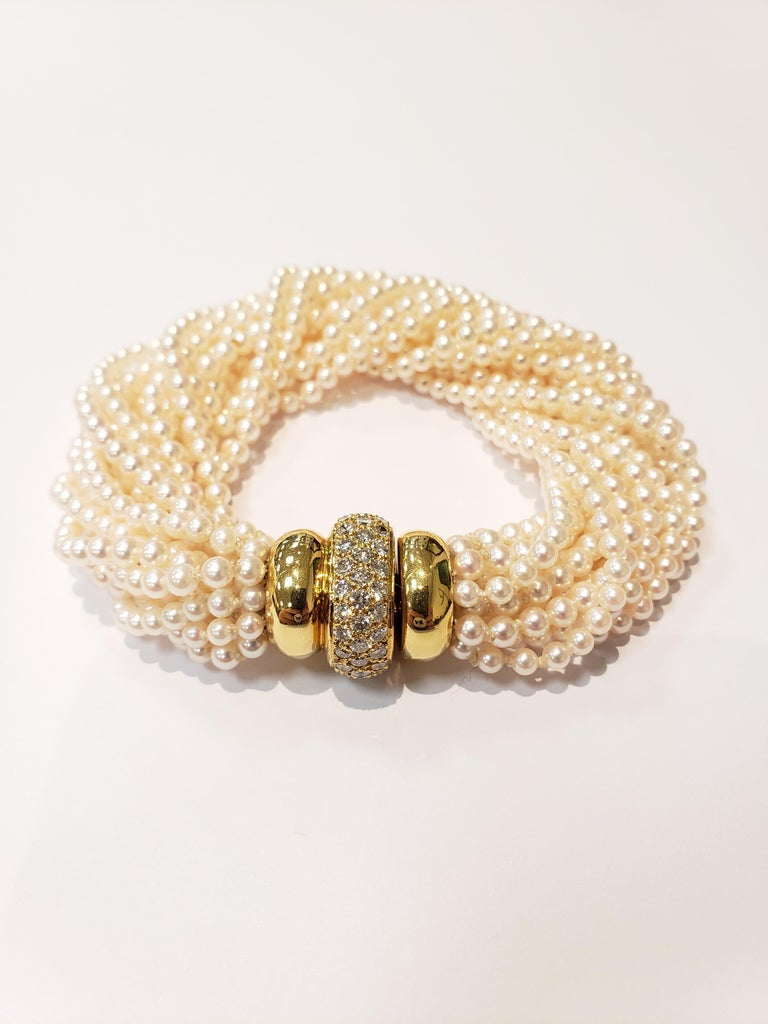 Round Cut Multi Strand Seed Pearl Bracelet with 18 Karat Gold and Pave Diamond Clasp For Sale