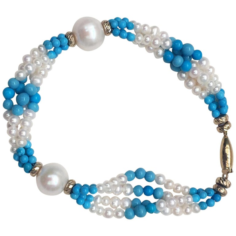 Multi Strand White Pearl and Turquoise Bracelet with 14 Karat Yellow Gold Clasp For Sale