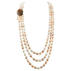 Multi-Strands Beaded Pearl Necklace with 9 Karat Rose Gold and Silver Closure