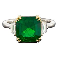 Gold 2.89 Carat GIA Certified Emerald Cut Emerald & Diamond Three-Stone Ring