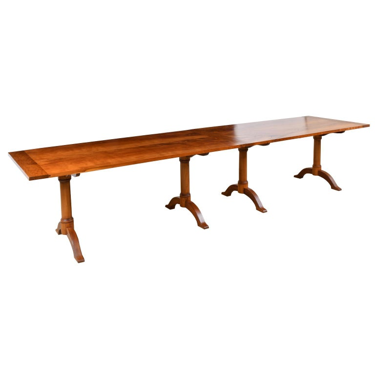 Inspired by a Shaker table in Hancock Village, Massachusetts, this versatile table, comprising of two (2) tables in American cherry can be set up using several configurations. When assembled end-to-end, it is 12' long x 36