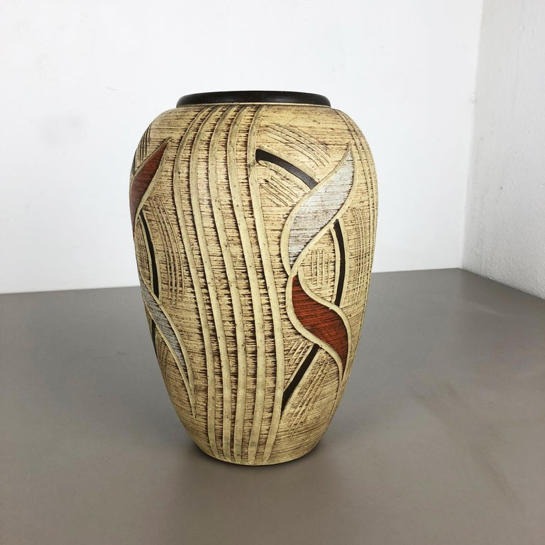 Article:  Pottery ceramic vase   Producer:  Sawa Ceramic, Germany   Design:  Franz Schwaderlapp    Decade:  1960s      Original vintage 1960s pottery ceramic vase in Germany. High quality German production with a nice