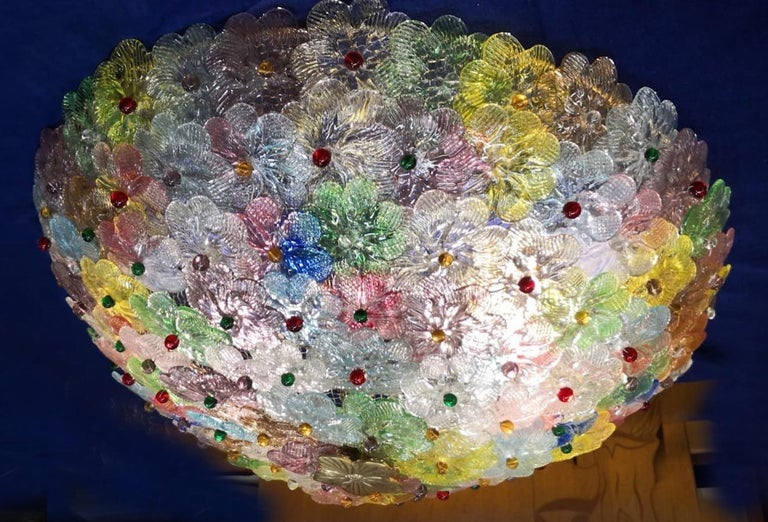 Amazing Mid-Century Modern hand blown Italian flush mount chandelier featuring overlapping  multicolor crystal flowers, mounted on a webbed white painted frame.  Measures: Height 9.45 in. (24 cm). Diameter 23.62 in. (60 cm). 5 x E27 \ 4 watt light