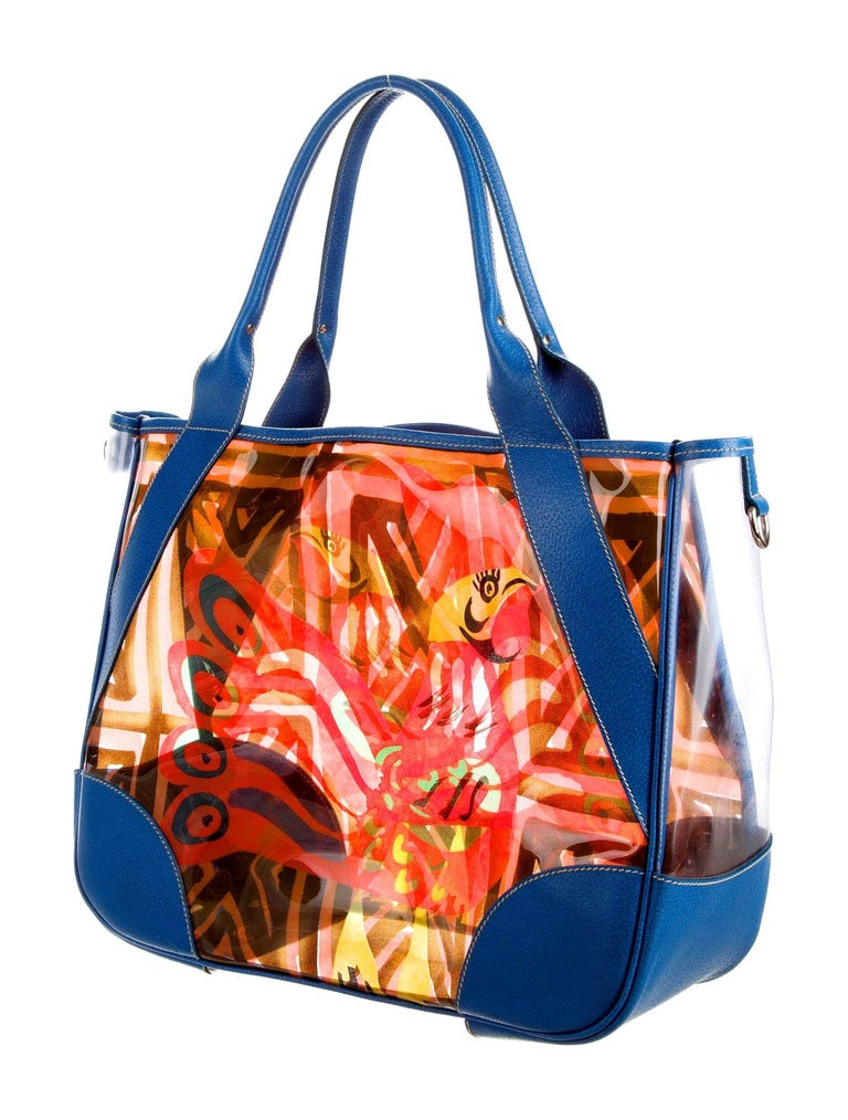 A playful Prada printed bag ready for your next beach or pool day Be different - a rare and special bag not everyone is carrying! Printed PVC / Vinyl - perfect, water-resistant and durable to carry wet beachwear but can also be used as a regular