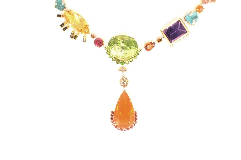 Tori Necklace An entirely handmade necklace created in eighteen-karat gold and platinum, set with different colours and shades of natural gemstones and diamonds.  This piece begins with a central motif consisting of a 24.45 carat peridot, suspending