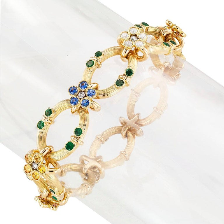 Estate  multi colored sapphire diamond emerald and yellow gold link bracelet circa 1990.  Love it because it caught your eye, and we are here to connect you with beautiful and affordable jewelry.  It is time to claim a special reward for Yourself!