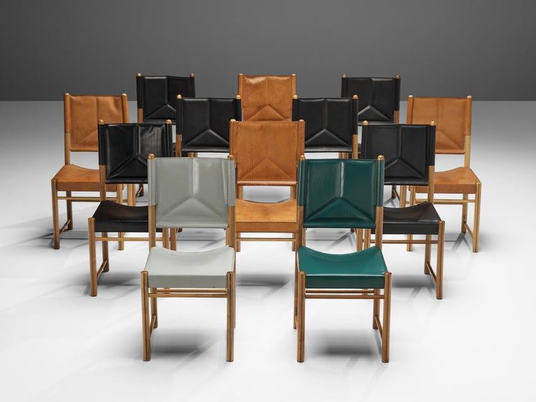 Set of dining chairs, leather, walnut, Italy, 1980s  This striking set of dining chairs surprises with a color range from green, black and grey to cognac. Together the colorful leather seats and backrests form an admirable set. The curved seat and