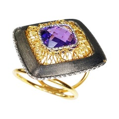 Multifaceted Amethyst in Titatium and 18 Karat White and Yellow Gold Ring