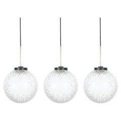 Multiple BAG Turgi Glass Brass Globe Pendant Lamps, circa 1960