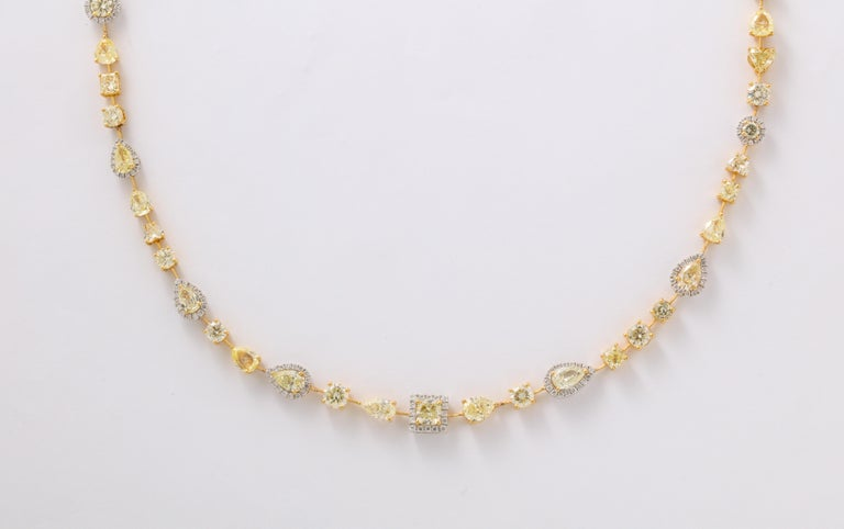 A beautiful WEARABLE design.   23.16 carats of yellow and white diamonds set in 18k white and yellow gold.  This necklace features heart, princess, round, pear, cushion and oval shapes.   18.5 inch length -- Available in different lengths as well.