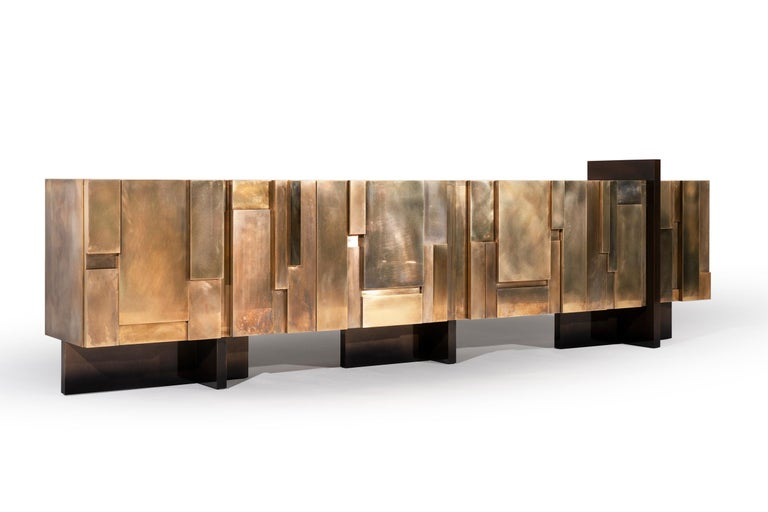 MUR - 21st century unique contemporary brass large freestanding sideboard  No matter how you look at MUR sideboard – from the top or from the side, it resembles a busy city's skyline. If you blur your gaze, you may recognize in the multiple
