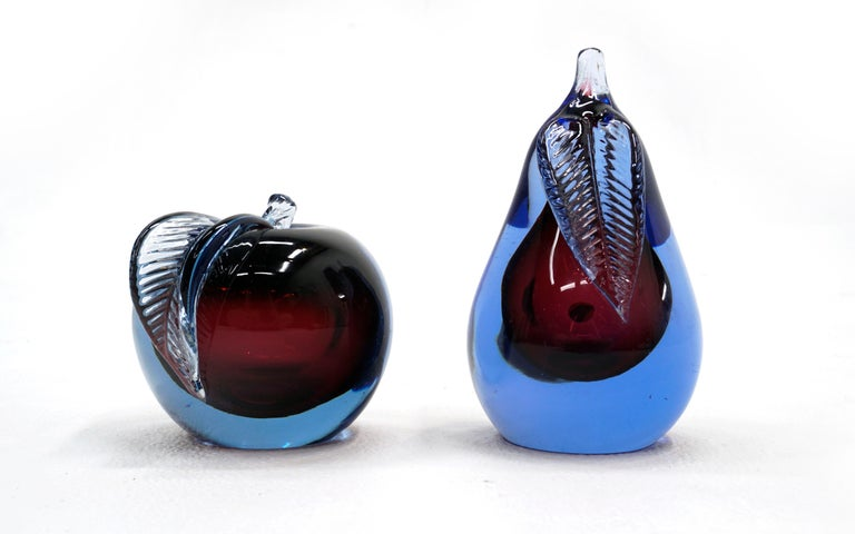 Murano art glass apple and pear Sommerso blue and purple designed by Alfredo Barbini. Both have two flat surfaces for display or can be used as bookends. No chips or repairs. May show minor wear on flat surfaces.