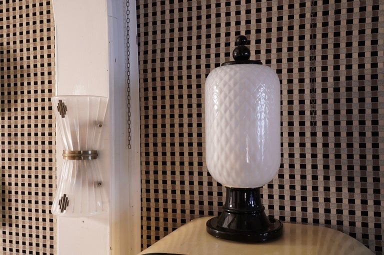 Superb pair of lanterns / table lamps in black and white Murano glass; a classic combination of the midcentury period.