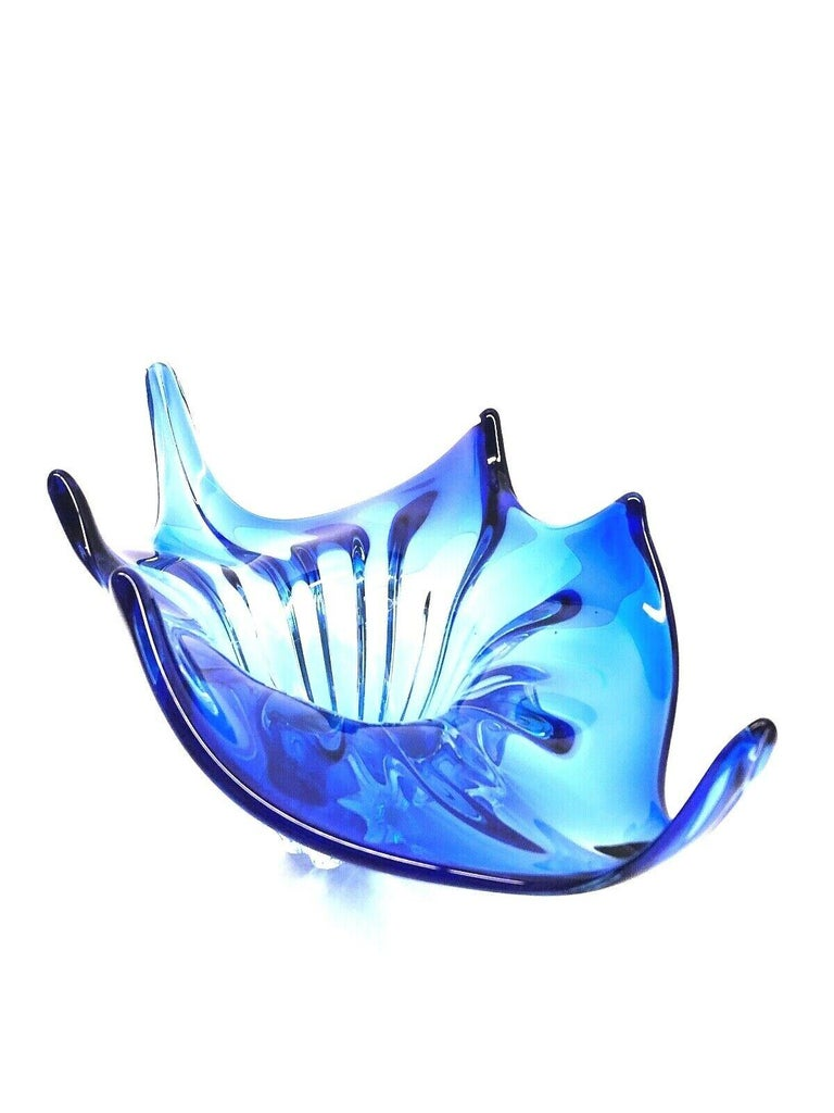 An amazing Venetian Murano glass bowl in a nice royal blue and clear color. A highly decorative piece useful as centre piece or bowl, candy bowl or fruit bowl, Italy, 1970s.