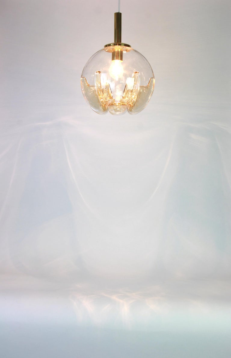 Doria ceiling light with large volcanic Murano glass ball. High quality of materials - gives a wonderful light effect when it is on.  Heavy quality and in very good condition. Cleaned, well-wired and ready to use. The fixture requires one E27