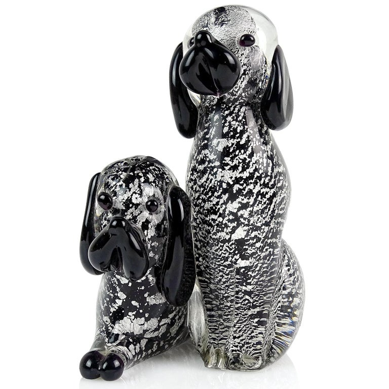 Beautiful vintage Murano hand blown black and silver flecks Italian art glass double puppy dog sculpture / figurine. The figure has 2 dogs attached to each other. Underneath there are 2 labels. One label reads