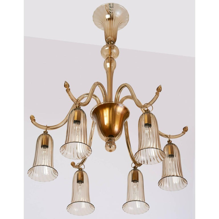 NAPOLEONE MARTINUZZI for VENINI An elegantly formed Murano blown glass six branch chandelier by Venini with gracefully shaped arm supporting fluted tulips, all in delicately colored straw glass, Italy, circa 1930 Rewired for use in the USA with six