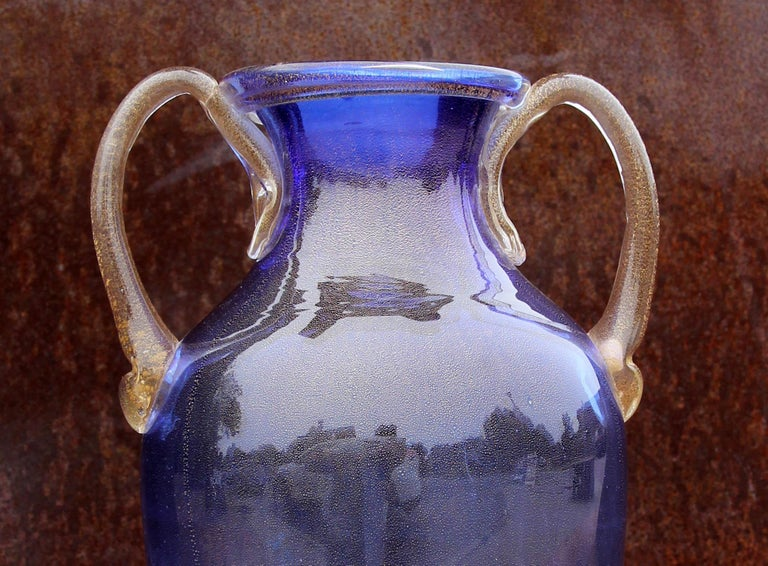 Murano blue glass two handle vase decorated with gold fleck interior. Amphora form.