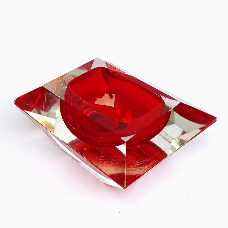 This is a Ruby-cut and Ruby-colored sculpture. Murano ashtray or bowl, attributable to Flavio Poli, Vetro Sommerso. Red faceted glass, Italy, 1950s.  No chipping.