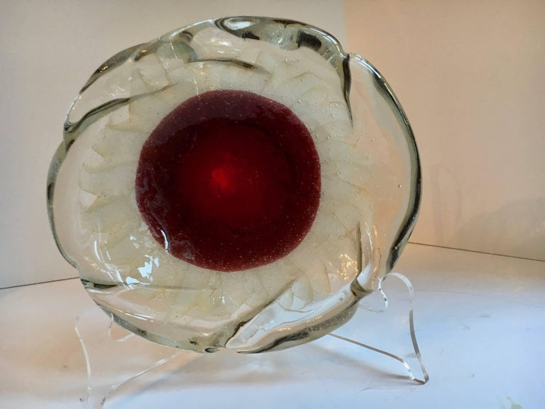 A spectacular Murano Bowl - rare and desirable, this piece has a large red centre with accents of 24-karat gold in the reverse.