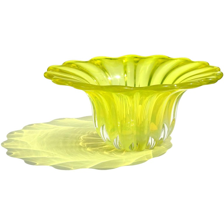 Beautiful large vintage Murano hand blown Sommerso bright yellow and opalescent Italian art glass centerpiece bowl / vase. Created in the manner of designer Alfredo Barbini. It has a ribbed body with flared out scalloped rim. In a darker background,