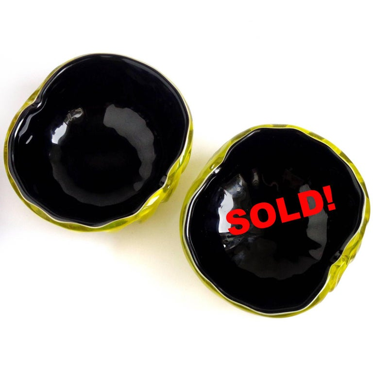 Only 1 Left! Beautiful, rare color combination, vintage Murano hand blown yellow over black Italian art glass decorative bowl. Attributed to the Fratelli Toso Company. There is a layer of white in between the colors. The bowl has a ribbed pattern.