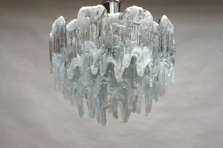 A vintage Italian chandelier composed of 34 frosted Murano glass parts, Italy.